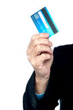 Cropped image of a man showing credit card Stock Photography