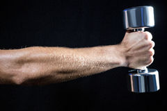 Cropped image of man working out with dumbbell Royalty Free Stock Photo