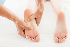 Cropped image of masseur giving foot massage to woman Stock Image