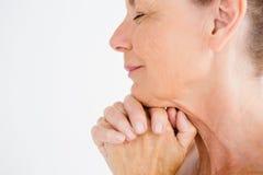 Cropped image of mature woman praying Stock Image