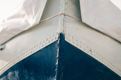 Cropped image of a metal boat covered with tarpaulin Stock Images