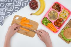 cropped image of mother preparing kids dinner for school royalty free stock photos