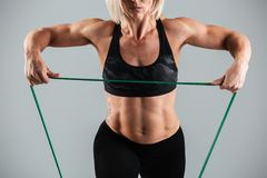 Cropped image of a muscular adult sportswoman Stock Images
