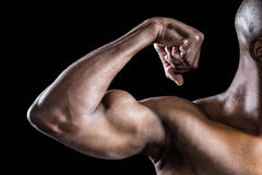 Cropped image of muscular man flexing muscles Stock Image