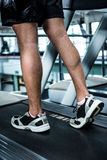 Cropped image of muscular man using treadmill Stock Images