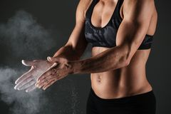Cropped image of a muscular sportswoman Stock Photography