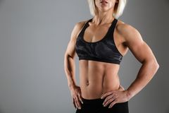 Cropped image of a muscular woman in sportswear Stock Images