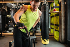 Cropped image of a muscular young sportsman doing cardio exercises Stock Photography