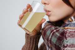 Cropped Image Of Sick Young Lady Drinking Medicine