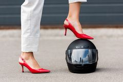 Free Cropped Image Of Woman In Red High Heels Putting Leg On Motorcycle Helmet On Street Royalty Free Stock Photography - 127755277