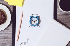 Cropped image of office accessories. Break at work, time for cof. Fee Royalty Free Stock Photo