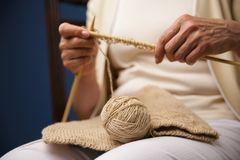 Cropped image of old woman knitting. Stock Photography