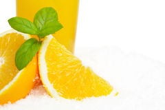 Cropped image of orange juice with ice cubes and leaves on ice Stock Images