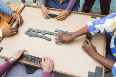 Cropped image of people playing domino on street Stock Images