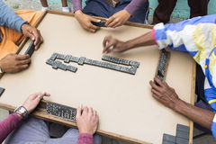 Cropped image of people playing domino on street Stock Photo