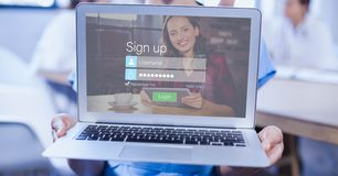Cropped image of person holding laptop with networking sign up page. Digital composite of Cropped image of person holding laptop with networking sign up page Royalty Free Stock Photo