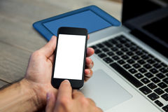 Cropped image of person using mobile phone Stock Images