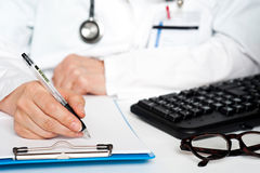 Cropped image of a physician writing prescription Royalty Free Stock Photo