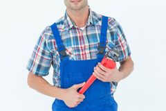 Cropped image of plumber holding monkey wrench Royalty Free Stock Images