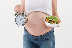 Cropped image of pregnant woman observes a diet Stock Photography
