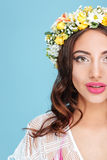 Cropped image of pretty girls face wearing flower wreath Royalty Free Stock Image