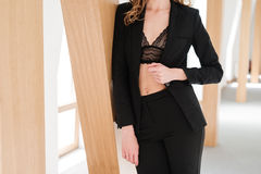 Cropped image of Pretty woman in suit and bra Stock Photos