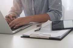 Cropped image of professional businesswoman working at her office via laptop young female manager using portable computer device. royalty free stock image