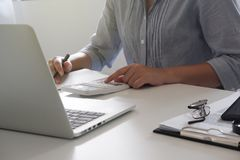Cropped image of professional businesswoman working at her office via laptop young female manager using portable computer device stock photography