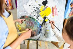 Cropped image of pupil painting on lesson in workshop of. Art school royalty free stock photos