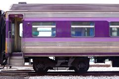 Cropped image of purple bogie of  train on railway. Royalty Free Stock Images