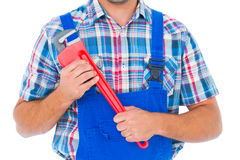 Cropped image of repairman holding monkey wrench Stock Image