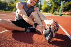 Cropped image of a runner suffering from leg cramp Stock Images