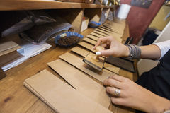 Cropped image of salesperson stamping paper bags at coffee store Royalty Free Stock Photos