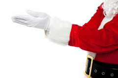Cropped image of Santa open palms Stock Photos