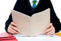 Cropped image of a school boy holding books Stock Photo