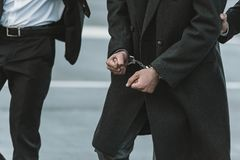 Cropped image of security guard holding man stock image