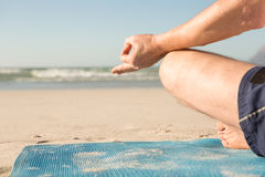 Cropped image of senior man meditating at beach Royalty Free Stock Images
