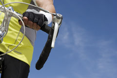 Cropped Image Of A Senior Man Riding Bicycle. With sky in the background Stock Photography