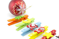 Cropped image set of cloth clip with christmas decoration icon with red ball. Stock Photography