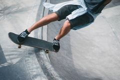 Cropped image of skater skating on longboard. At skatepark Stock Images