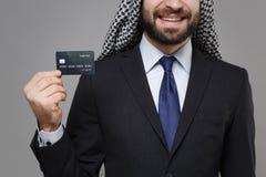 Cropped image of smiling arabian muslim businessman in keffiyeh kafiya ring igal agal classic black suit  on