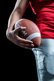 Cropped image of sportsman holding American football Stock Photos