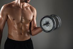 Cropped image of strong young sports man make sports exercises Stock Photo