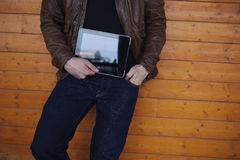 Cropped image with stylish young man holding digital tablet with a blank screen Stock Image