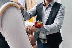 First fitting. Cropped image of tailor fitting bespoke suit Stock Images