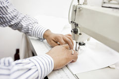 cropped image of tailor sewing cloth on sewing machine Royalty Free Stock Images