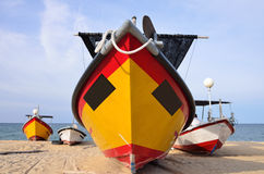 Cropped image of tradisional fisherman boat park on the sandy beach Royalty Free Stock Image