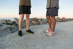 Cropped image of two men in sportswear standing together Royalty Free Stock Photo