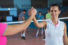 Cropped image of volleyball player holding hand with teammate Stock Photography