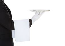 Cropped image of waiter holding empty tray Stock Photos